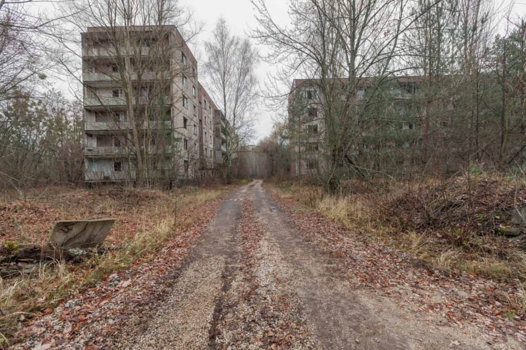 Abandoned buildings in overgrown ghost city Pripyat.